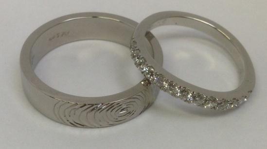 Palladium with fingerprint detail, platinum with scallop set diamonds