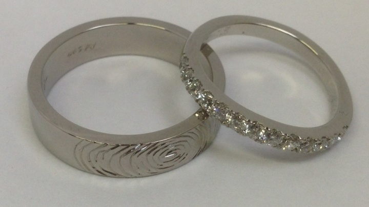 Palladium with fingerprint detail, platinum with scallop set diamonds